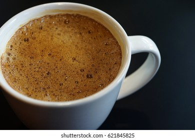 Close up of black coffee on a dark background
