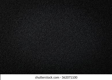 Close up black color rough plastic surface texture background