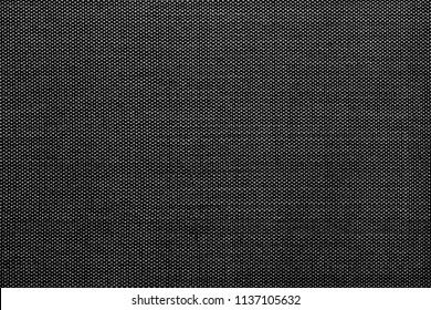 Close up black Cotton Pinpoint Oxford fabric texture is commonly used to manufacture men's dress shirts, for everyday work shirts. Black cotton shirt texture.