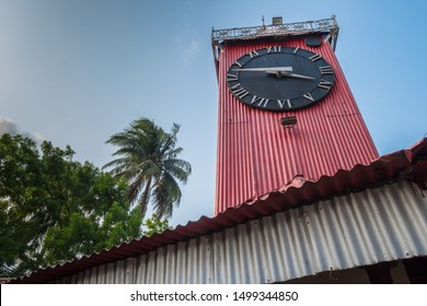 A close up of the black face of Ali Amjad's Clock the British Empire era red clock tower, a popular tourist attraction in downtown Sylhet.