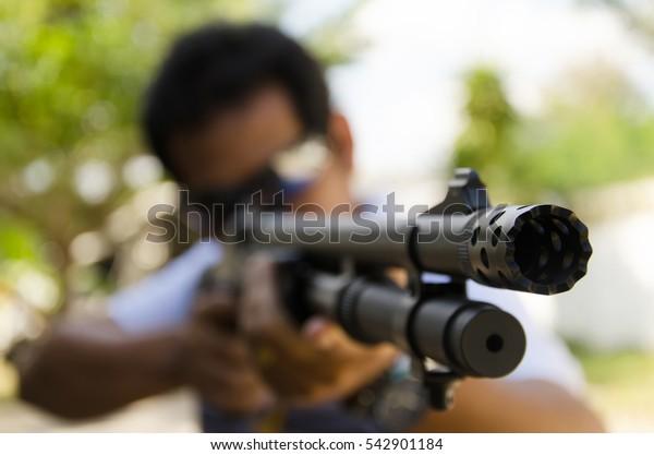 Close up black handgun holding in a man's hand