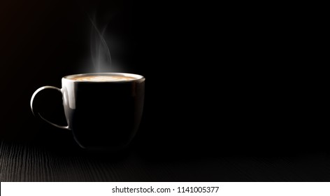 Close up black hot coffee cup and smoke with latte art foam on black wood table at cafe.dark scene.banner space mock up for adding text
