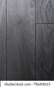 Close up black laminate floor background texture