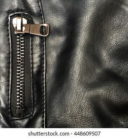 Close up of black leather jacket zipper