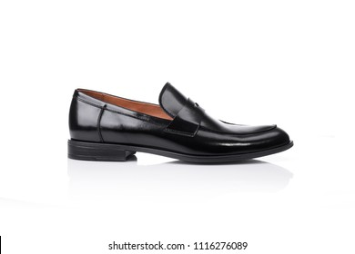 Close up of a black men penny loafers shoes on white background with reflection. Fashion advertising shoes photos.