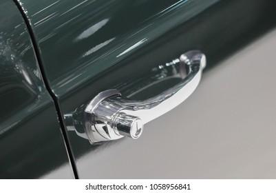 The close up of black oldtimer door handle.