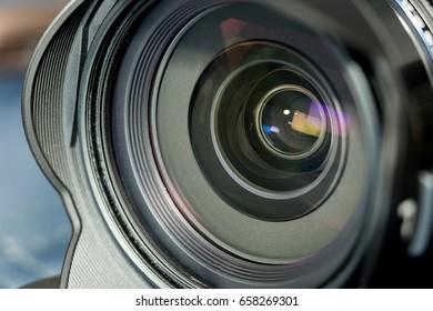 Close up of black optical lens of digital camera