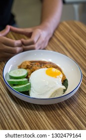 Close up black paper beef and chicken katsu with half boiled egg