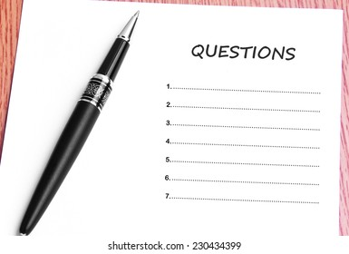 Close Up Black Pen And Paper On The Table And Questions List