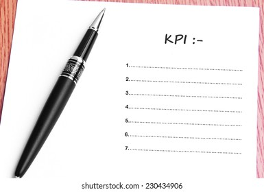 Close Up Black Pen And Paper On The Table And KPI List