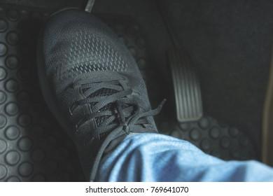 Close up Black Shoe ob pedal in car