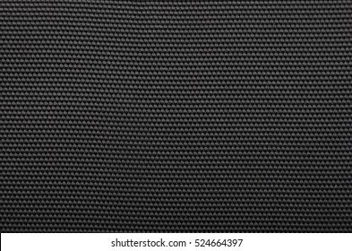Close up of black textured synthetical background