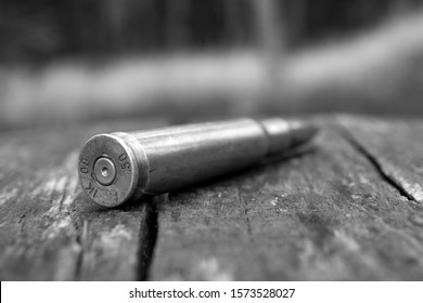 close up of black and white 50 mm caliber bullet background