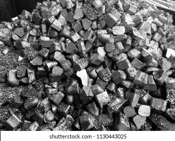 Close up black and white  aluminum alloys, The fraction of aluminum or metal or ore that is a heap is on the stock for melting or using other in the job industry