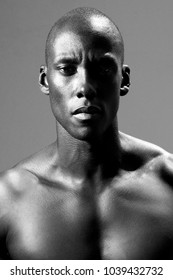 Close up black and white photo of african man staring