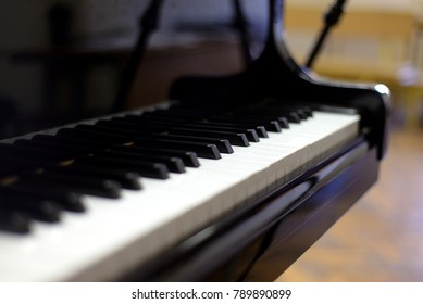 Close up of black and white piano keyboard.