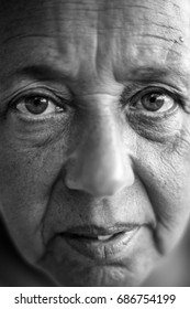 Close up black and white portrait of elderly lady . Narrow focus on eyes