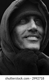 close up black and white portrait of urban man looking to the side with big smile