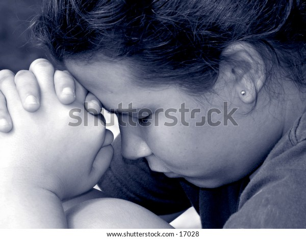 close up black and white of a young teen girl in prayer