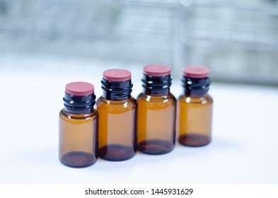 Close up blank brown bottle reagent in laboratory.
