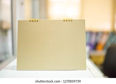 Close up blank calendar in gold tone.