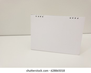 Close up blank calendar on table whit white background in mock up concept  ** Note: Visible grain at 100%, best at smaller sizes