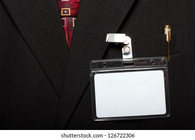 close up of blank id card on man's suit