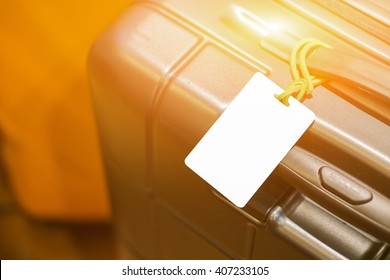 Close up of blank luggage tag label on suitcase or bag with TRAVEL INSURANCE ,Can be used for montage or display your products,selective focus,vintage color