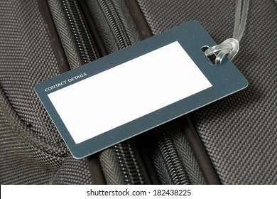Close up of blank luggage tag on suitcase