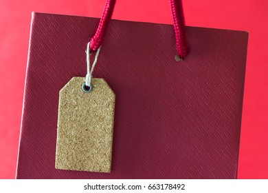 Close up of blank tag on red paper tag