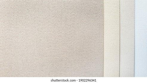 close up blind or curtain linen fabric texture samples in color chart. warm tone color of textile fabric with sunproof function for home or office . interior material selection.