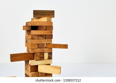 Close up blocks wood game on white wooden table background. With copy space for text or design concept