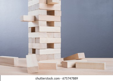 Close up blocks wood game on wooden table background. With copy space for text or design concept