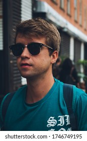 Close up blond boy with sunglasses