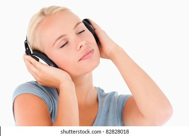 `Close up of a blond woman with headphones in a studio
