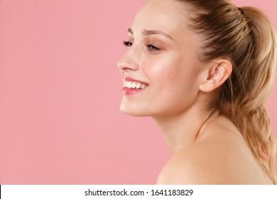 Close up blonde half naked woman 20s perfect skin nude make up blue eyes isolated on pastel pink wall background studio portrait. Skin care healthcare cosmetic procedures concept. Mock up copy space