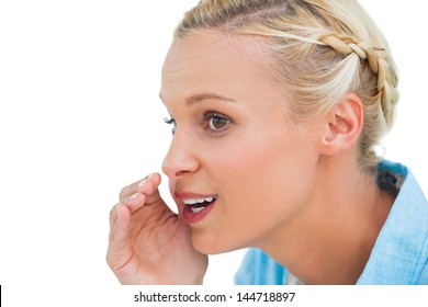 Close up of a blonde speaking to someone and looking at something on white background