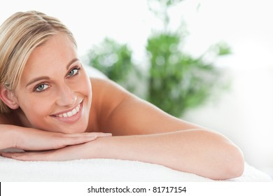 Close up of a blonde woman lying on a lounger in a wellness center
