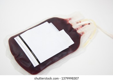 Close up blood bag on table on white background.