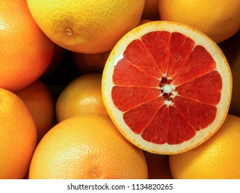 close up  blood oranges or  grapefruits for sale on a market