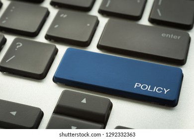 Close up blue button laptop keyboard selective focus on word POLICY. Vision, organization plan, guildline and business management concepts.