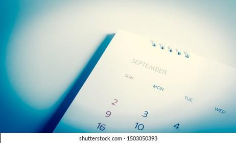 Close up Blue calendar Septem ber in planning concept.