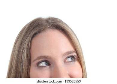 Close up of blue eyes of a woman looking above isolated on a white background