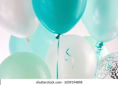 Close up blue, green and white air balloons