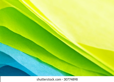 Close up of blue green and yellow tissue paper