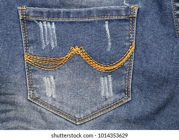 close up blue jeans back pocket.