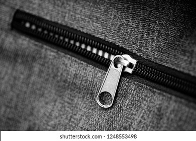 close up Blue jeans and black zipper,Blue fabric material texture macro zipper.black and white style.