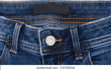 close up -blue jeans with front pocket and seams