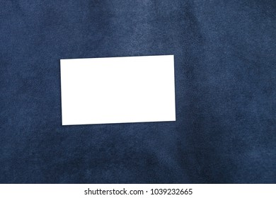 Close up of blue leather background or texture. white business card on brown leather lining