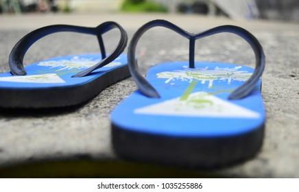 close up blue sandals put on ground